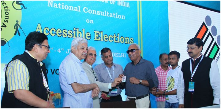 CEC Shri O P Rawat and ECs Shri Sunil Arora and Shri Ashok Lavasa facilitating Persons with Visual Impairment with Braille enabled EPIC card