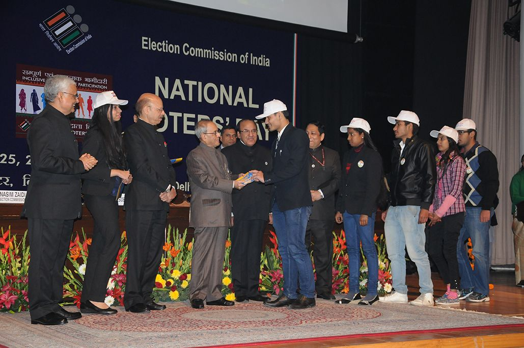 Honble President of India, handing over the EPIC to newly eligible electors