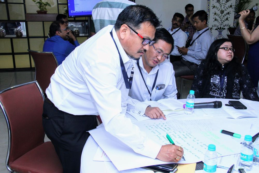 Participants preparing for their activities during SLMT workshop in New Delhi..JPG