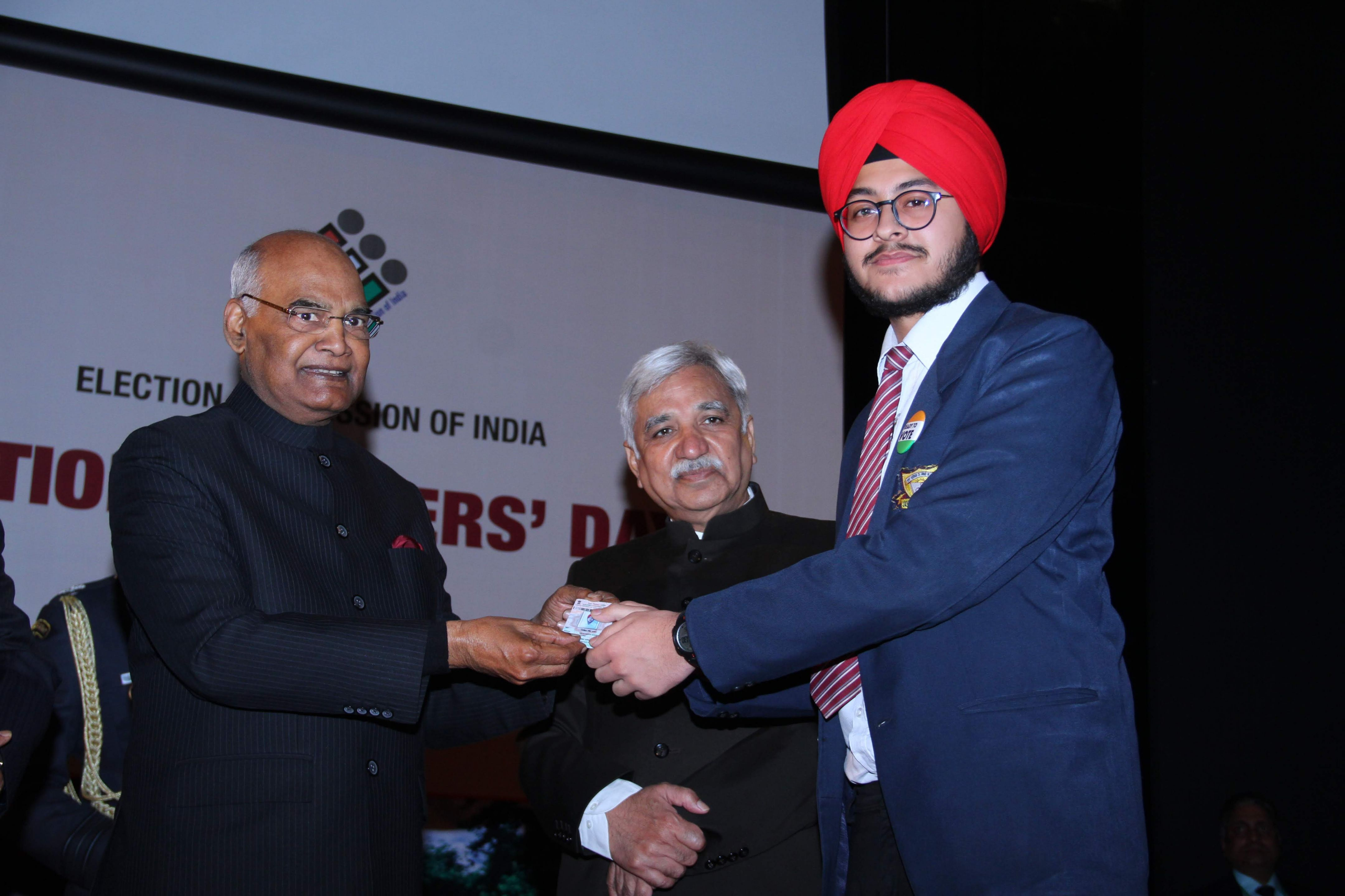 Hon'ble president felicitating a newly eligible voter from Delhi with EPIC